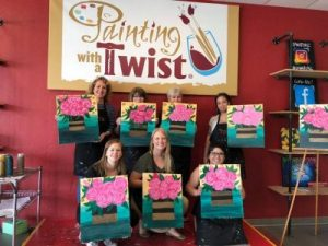 Wedel Rahill team afternoon, the women are holding paintings they did